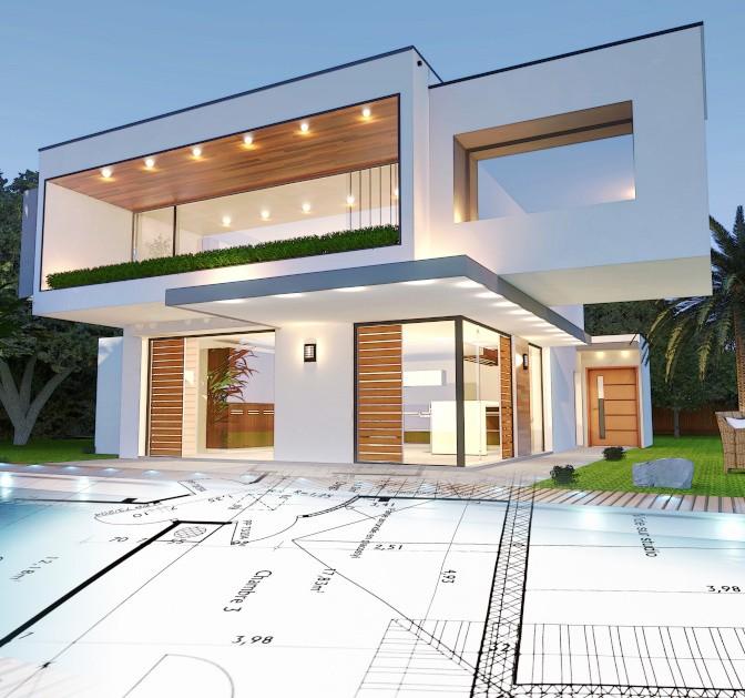 Biały dom z jasno brązowymi oknami i drzwiami na le niebieskiego nieba